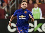 (Files) In this file picture taken on July 29, 2014, Manchester United's Luke Shaw runs with the ball during a Champions Cup match against Inter Milan at FedEx Field in Landover, Maryland. Luke left Southampton for Manchester United for £27 million (rising to £31 million)*. After a fine 2013-14 campaign, which saw him supplant Ashley Cole in the England squad, 19-year-old left-back Shaw joined United in a move that made him the fourth-most expensive defender in history. Currently sidelined by a hamstring injury.   AFP PHOTO/Nicholas KAMMNICHOLAS KAMM/AFP/Getty Images