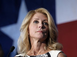 """FILE - In this Aug. 26, 2014, file photo, Texas Democratic gubernatorial candidate Wendy Davis presents her new education policy during a stop at Palo Alto College in San Antonio. Davis reveals in a new campaign memoir called """"Forgetting to be Afraid"""" that she terminated two pregnancies for medical reasons in the 1990s, including one where the fetus had developed a severe brain abnormality. (AP Photo/Eric Gay, File)"""