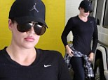 Khloe Kardashian shows off svelte figure in slimming black ensemble as she completes another workout session