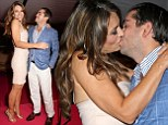 Magic moment: Liz Hurley sold off a smooch to the highest bidder at Elton John's annual Summer Ball in Windsor on Thursday