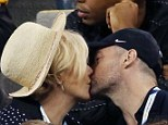 Kissing couple: Hugh Jackman and his wife Deborra-Lee Furness shared a kiss on Thursday at the US Open tennis tournament in New York City