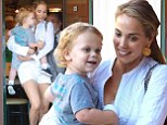 You're putting on a Showgirl! Elizabeth Berkley flaunts her perfect pins in hotpants as she takes son Sky for yoghurt in LA