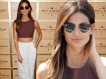Who said no white after Labor Day? Lily Aldridge ignores fashion tradition in a midriff baring ensemble at the US Open