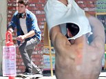Quick change! Zac Efron strips down after a skateboarding session on set