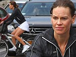 Toning up: Hilary Swank showed off her sculpted legs as she took a bike ride around New York City on Friday