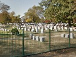 The worker at St. John's Cemetery is in stable condition after falling backwards into an open grave