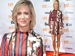Kristen Wiig parades her perfect legs in floral and stripe patterned frock for film premiere in Toronto
