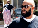 Suge Knight pictured for first time since being shot at Chris Brown's VMA pre-party as he heads out on clothes shopping trip