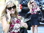 No Casual Friday for her! Reese Witherspoon dons stylish peplum skirt and floral top
