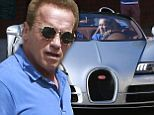 2744550 He'll be back! Arnold Schwarzenegger looks as cool as they come as he hops into sports car after visiting his office in Los Angeles