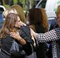 epa04386401 Unidentified mourners embrace before entering a memorial service for US freelance journalist Steven Sotloff at Temple Beth Am in Pinecrest, Florida, USA, 05 September 2014. Sotloff was executed by the Islamic State according to a video released by the group on 02 September.  EPA/JOE SKIPPER .