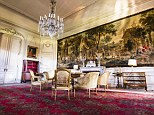 Opulent: The drawing room is filled with antique furniture and an enormous tapestry fills the whole of one wall, while the chandelier hints at an opulent past