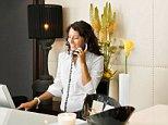 B7D8DM Female receptionist talking on the phone