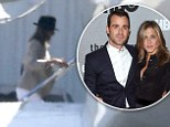 Heading somewhere romantic? Jennifer Aniston and fiance Justin Theroux spotted boarding a private jet