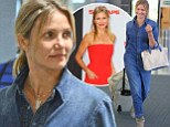What a difference a day makes! Cameron Diaz touches down in baggy denim jumpsuit and no make-up after wowing at premiere