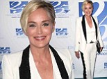 She means business! Sharon Stone shows off her quirky style in three-piece white suit with black lace trim at charity event