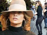 Showing it all: Jennifer Lopez displayed her derriere in leggings as she grabbed lunch with a friend in New York City on Saturday