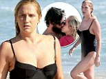 Love in the afternoon: Kesha reveals supermodel-worthy figure on beach as she gets a kiss from boyfriend Brad Ashenfelter