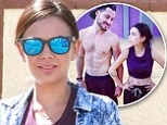 Ripped: The 25-year-old actress displayed her taut tummy and belly button ring in a purple crop top and sweatpants as the 28-year-old dance pro went shirtless, revealing his sculpted upper body
