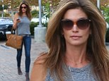 Looking better than ever! Cindy Crawford, 48, shows off toned legs in skin-tight jeans as she steps out in Malibu