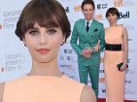 Eye-catching: Felicity Jones and Eddie Redmayne brightened up the red carpet in pastel ensembles at the TIFF premiere of The Theory Of Everything on Sunday