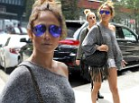 Jennifer Lopez, 45, shows off toned pins as she dons white Daisy Dukes