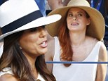 Hats how you do it! Eva Longoria and Debra Messing are style twins as they watch Serena Williams win the US Open final