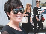 Influencing each other: Kris Jenner appeared to be copying her daughters as she rocked a flannel jacket round her waist while out for lunch with a gal pal in Beverly Hills on Sunday