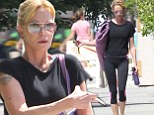 Feeling the strain? A very thin Melanie Griffith puffs away on a cigarette as she heads to yoga following news ex Antonio Banderas has moved on