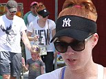 Go team! Actress Amy Adams wears a black New York Yankees sun visor and black leggings while on a family outing in LA