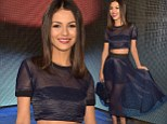 No scandal here! Victoria Justice bares her midriff in stunning navy see-through outfit at DKNY show at New York Fashion Week