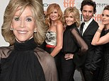 She's HOW old? Jane Fonda, 76, shows off her toned arms in a sheer-sleeved pantsuit and puts on an energetic display at the Toronto Film Festival