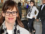What a difference a day makes! Jennifer Garner hits the airport with messy hair and no make-up after wowing at premiere