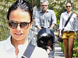 Family bonding: Jordana Brewster took a sunny stroll with her son Julian Form - who turns one on September 21 - and dad Alden in Los Angeles on Sunday