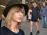 Who needs pants anyway? Taylor Swift puts on a long and leggy show in thigh-skimming shirt dress