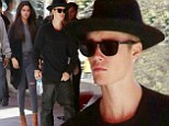 Jelena has landed! Justin Bieber and Selena Gomez make their way along a crowded street as they arrive at Toronto hotel