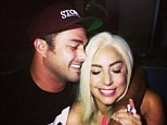 'So much fun we're screaming!' Lady Gaga and her 'country boy' Taylor Kinney enjoy a romantic date night at the Garth Brooks concert