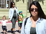 Pregnant Kourtney Kardashian displays her blossoming belly as she enjoys bonding time with children Mason and Penelope