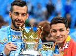 File Photo: Alvaro Negredo expected to complete a loan deal with Valencia Manchester City's Alvaro Negredo (left) and Jesus Navas celebrate with the Premier League trophy ... Soccer - Barclays Premier League - Manchester City v West Ham United - Etihad Stadium ... 11-05-2014 ... Manchester ... UK ... Photo credit should read: Mike Egerton/EMPICS Sport. Unique Reference No. 19800149 ...