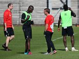 Mario Balotelli chats to his manager Brendan Rodgers in training at Melwood today. 9 September 2014. Please byline: Peter Goddard/Vantagenews.co.uk