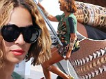 Beyonce embraces metallic temporary tattoo trend as she boards private jet in Nice with Jay Z and Blue Ivy