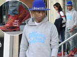 Pharrell Williams and his wife Helen step out in matching red boots... as he continues European tour