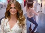 Millie Mackintosh dons see-through lace shirt and ripped jeans as she straddles a mannequin at clothing launch