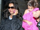 Home sweet home! California girls Katie Holmes and Suri Cruise arrive back to their West Coast digs after relocating from New York