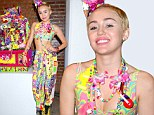 Miley Cyrus displays bare midriff in psychedelic bra top as she debuts first art installation at Jeremy Scott NYFW fashion show