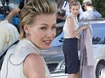 Portia de Rossi goes business chic as she films scenes for Scandal... as 'top secret' recurring role on the show is still unknown