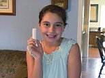 ADVANCE FOR SUNDAY SEPT 14 AND THEREAFTER - In this photo taken on Tuesday Sept. 9, 2014, Grace Karaffa, 11, a fifth-grader at Stuarts Draft Elementary School, holds up a stick of lip balm that she would like to be able to carry at school at her home in Stuarts Draft, Va.  The first day of the school year, Grace decided she'd take action and seek relief from Augusta County Schools' Chapstick ban, said her father, David Karaffa. (AP Photo/The Staunton News Leader, Calvin Trice)