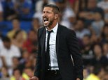 Atletico Madrid's coach Diego Simeone reacts during their Spanish Super Cup first leg soccer match against Real Madrid at the Santiago Bernabeu stadium in Madrid on August 19, 2014.    REUTERS/Juan Medina (SPAIN - Tags: SPORT SOCCER)