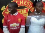 This couple in Kenya chose to get married with a Manchester United themed wedding the other day, with the theme specifically being that the groom appears to support Manchester United. A lot. While the bride doesn?t look too pleased in the above photo, she still went ahead with the ceremony anyway and presumably was aware that her husband to be was as obsessed with football as he apparently is before she agreed to marry him. Who knows, maybe she asked him to marry her. This is 2014 after all. Perhaps he actually hates Manchester United and is just doing this to please his wife.  Must provide link back to http://africagossipnews.com/kenya-kenyan-man-decides-to-have-a-manchester-united-themed-wedding-i-pity-the-bride-photosmust-read/