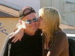 Smoochin' good time: The Eighties icon planted a kiss on the legendary rocker